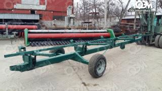 Uniaxial trolley for transportation of harvesters